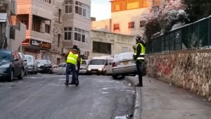 Clearing snow and ice in Issawiya