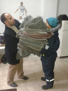 Baha collecting blankets