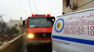 Fire and ambulance helping the family whose house collapsed in the Old City