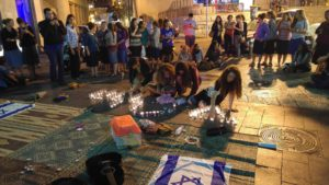 Lighting candles in Zion Square