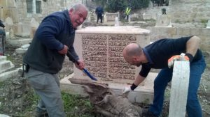 Cleaning up a special grave