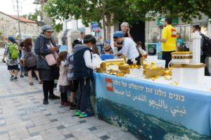 Diverse Jerusalemites building Jerusalem from lego