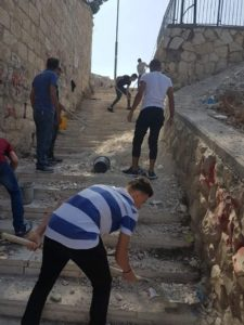 Cleaning up, repairing stairs in Ras al-Amud