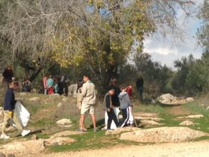 Scouts and other youth working to clean up the Valley