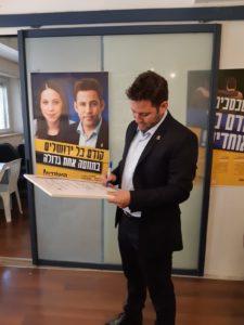 Ofer Berkovitz signing the Clean City Platform